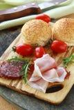 Salami, ham, and two buns with sesame seeds Stock Photos