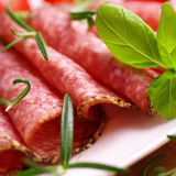 Salami with herbs Stock Image