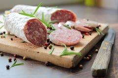 Salami with herbs Stock Photo