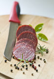 Salami with herbs and spices Stock Image