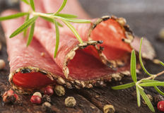 Salami with herbs and spices Stock Images