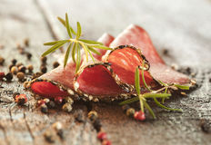 Salami with herbs and spices Royalty Free Stock Photography