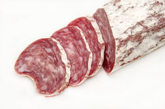 Salami. Iberico cured salami sliced on white background Stock Photo