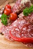 Salami italiano com faca Fotografia de Stock