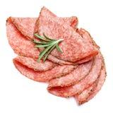 Salami italiano o chorizo español en el fondo blanco Foto de archivo