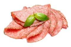 Salami italiano o chorizo español en el fondo blanco Imagen de archivo libre de regalías
