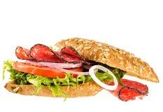 Salami kanapka z kukurudza chlebem na odosobnionym na bielu Zdjęcie Royalty Free