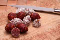 Salami and kitchen knife Royalty Free Stock Images