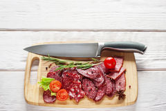 Salami and knife on cutting board free space Stock Photo