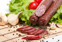 Salami with lettuce and tomatoes Stock Image