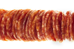Salami / macro picture of few slices isolated Stock Photos