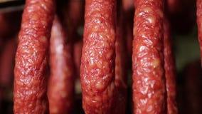 Salami. Making sausages at a sausage factory, salami, smoked sausage stock video