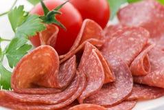 Salami mit Tomate Stockfoto