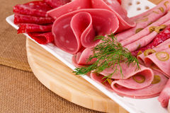 Salami, mortadella and bacon Stock Images