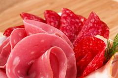 Salami, mortadella and bacon Royalty Free Stock Photos