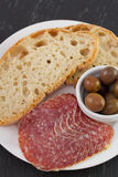 Salami with olives and bread Royalty Free Stock Photos
