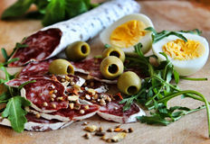 Salami, olives and eggs Royalty Free Stock Images