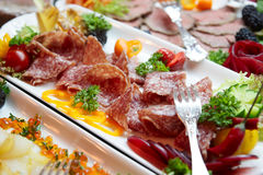 Salami and and other food. On restaurant buffet royalty free stock image