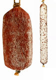 Salami. A pair of a thick and thin sausage stock image