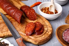 Salami with paprika. Rustic style. royalty free stock photo