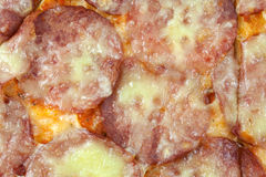 Salami pizza background Stock Photography