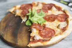 Salami pizza left over. Image Stock Photo