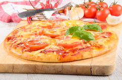 Salami pizza with tomato and cheese Stock Image