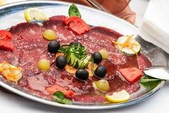 Salami plate Stock Image