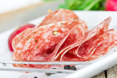 Salami on plate Royalty Free Stock Photo