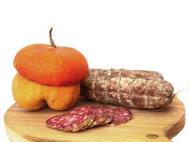 Salami and pumpkin composition Royalty Free Stock Photo