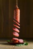 Salami with rosemary Stock Photo