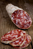 Salami on rustic wooden board Royalty Free Stock Images