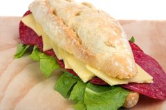 Salami Sandwich. On wooden surface whit farmhousel bread stock photography