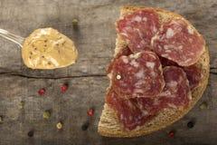 Salami sandwich Stock Images