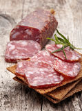 Salami sausage and bread Stock Photo