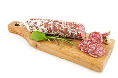 Salami sausage on cutting board  Royalty Free Stock Photography