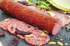 Salami sausage with dried chili pepper, garlic Stock Images