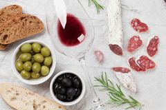Salami, sausage, olives and wine Stock Image