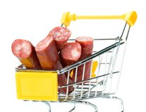 Salami sausage in the shopping cart Stock Photos