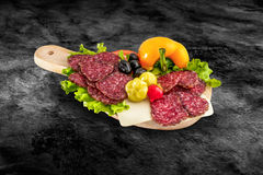 Salami sausage slice and vegetables on wooden board with clipping path Royalty Free Stock Image