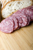 Salami sausage sliced with bread for sandwich. Italian salami sausage sliced with brick oven delicious fresh baked bread for sandwich stock images