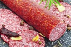 Salami sausage with slices around Royalty Free Stock Photo