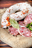 Salami sausage and spices Royalty Free Stock Photography