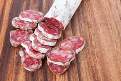 Salami sausage on wooden background Stock Photo