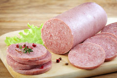 Salami sausage on cutting board Stock Images