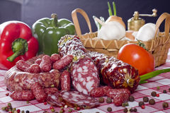 Salami sausage on a wooden plate stock images