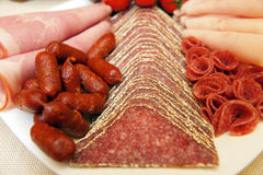 Salami sausages plate Royalty Free Stock Images