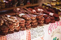 Salami and sausages sold in the stall at an outdoor market Italy Royalty Free Stock Photo