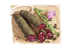 Salami sausages with spices Royalty Free Stock Photos
