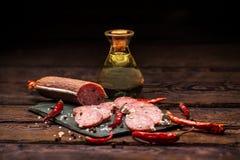 Salami on slate cutting board Stock Image